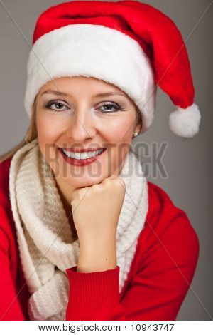 Woman in santa hat with christmas presents