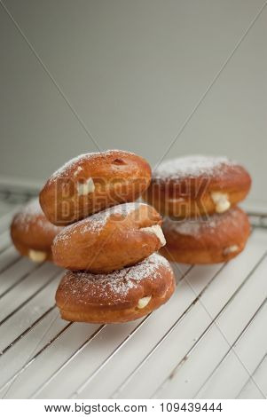 Donuts with sweet cream sprinkled with powdered sugar