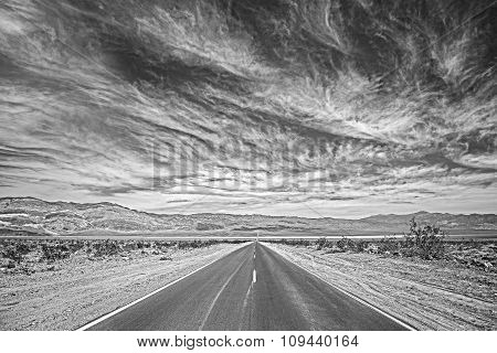 Black And White Photo Of A Highway In Death Valley, Usa.