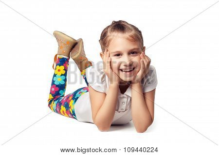 Blond Little Girl Laughing, Lying On His Stomach