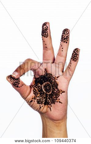 Unique henna tattoo on white background ok sign medallion design
