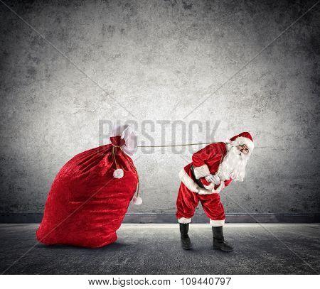 Santa Claus Dragging A Big Sack of Presents