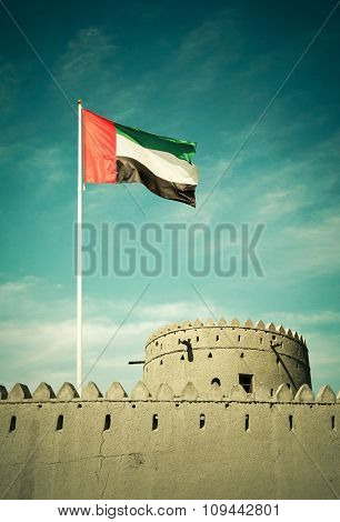 United Arab Emirates flag hoisted on an ancient burj.