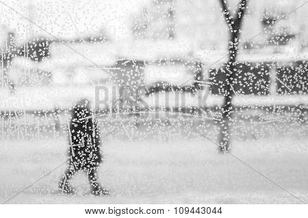 frozen window on ice background with womans silhouette
