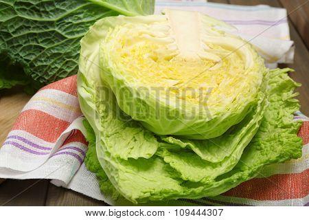 Cut savoy cabbage on wooden cutting board
