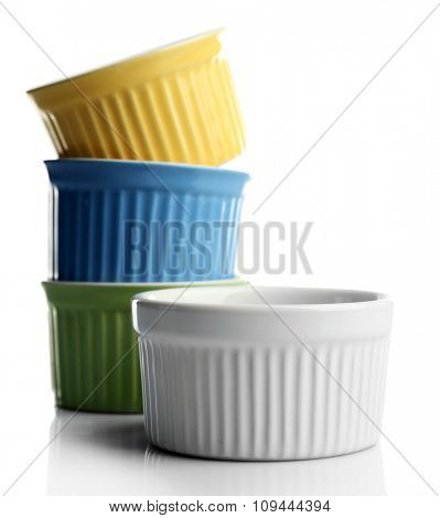 Four empty stacked ceramic bowls, isolated on white