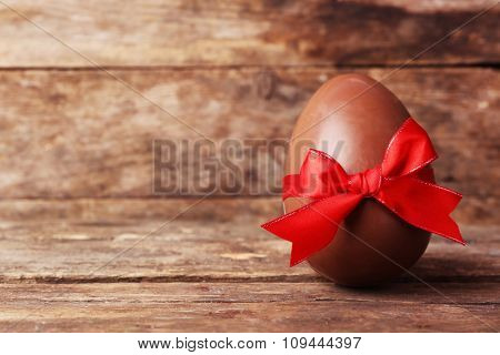 Chocolate Easter egg on wooden background