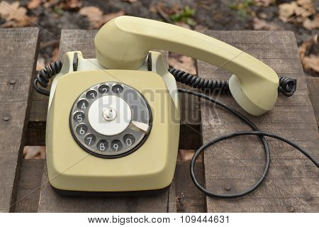 old telephone on a wooden table