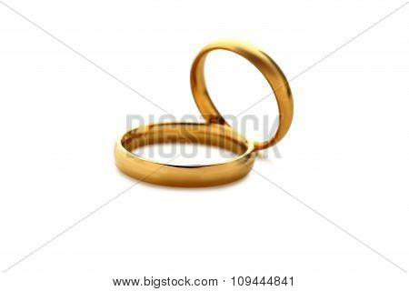 Golden Wedding Rings Isolated On A White