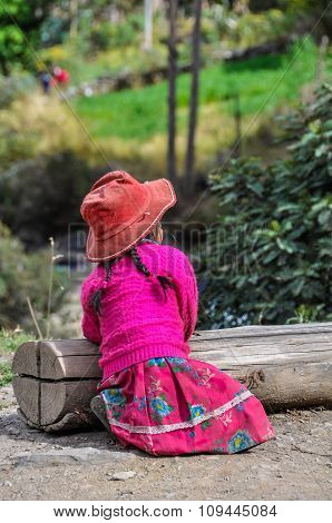 Quechua Girl With Hat In A Village In The Andes, Ollantaytambo, Peru