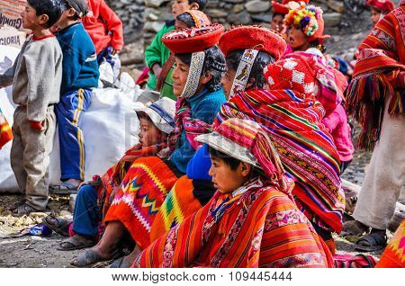 Quechua Family Waiting In A Village In The Andes, Ollantaytambo, Peru