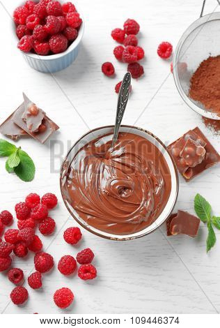 Beautiful composition with chocolate cream and raspberries