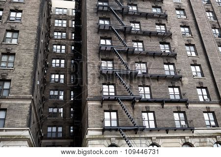 fire escape on the wall of old brick building