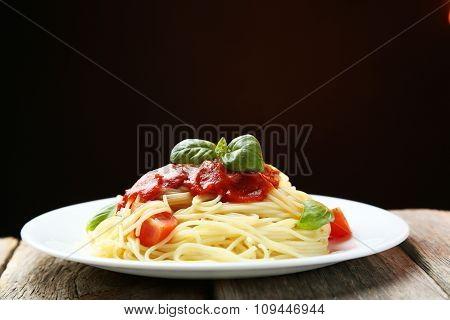 Spaghetti With Tomatoes And Basil On Plate On Grey Wooden Background