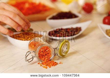 Dried carrots and variety of spices on the kitchen table