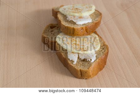 Slice of bread with lard and onion covered by paprika