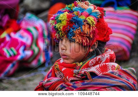 Quechua Girl Looking In A Village In The Andes, Ollantaytambo, Peru