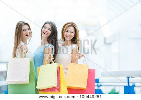 Young beautiful girl with shopping bags