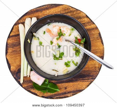 Top View Of Thai Soup Tom Yam In Bowl On Board