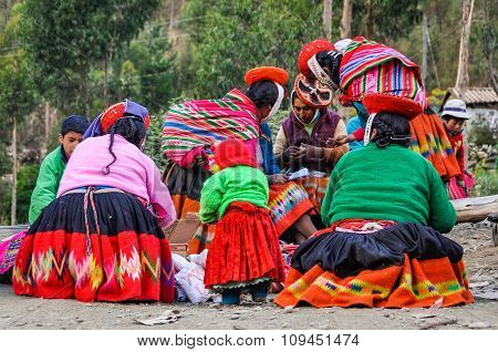 Quechua Group Talking In A Village In The Andes, Ollantaytambo, Peru