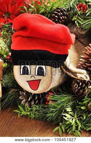 a Tio de Nadal, a typical Christmas character of Catalonia, Spain, made by myself, and some gifts and natural ornaments, such as pine cones