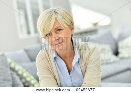 Portrait of senior woman relaxing in sofa