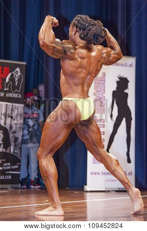 Male Bodybuilder Shows His Back Double Biceps On Stage