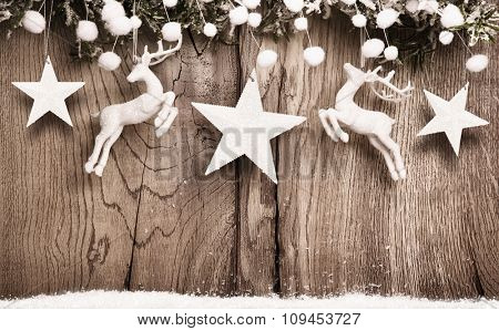 Christmas decoration with deer and stars on wooden background