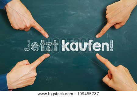 hands pointing to German slogan
