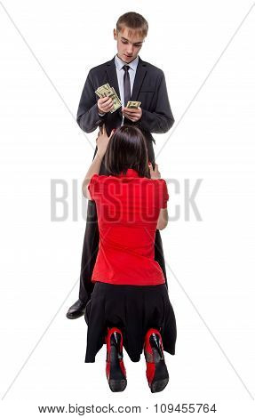 Man counting money near woman on her knees