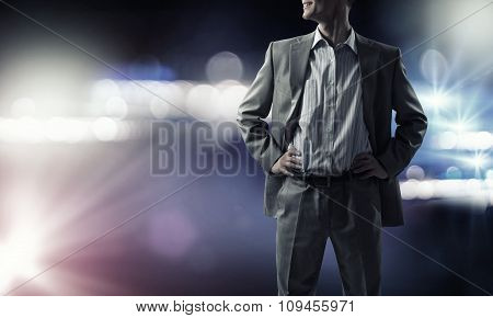 Confident businessman in bokeh lights