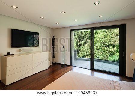 Interior of modern house, bedroom with television