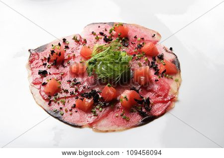 forefront of carpaccio of tuna  with diced tomatoes