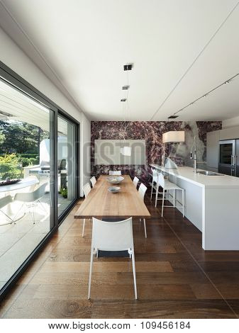 Interior of modern house, beautiful open space, kitchen and dining table