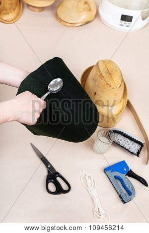 Hatter Applies An Adhesive A Felt Hood For Fixing