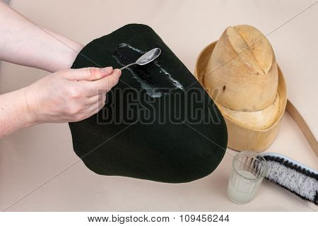 Hatter Applies An Adhesive A Felt Hood For Shaping