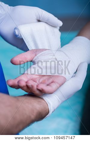 Strapping Patient's Arm
