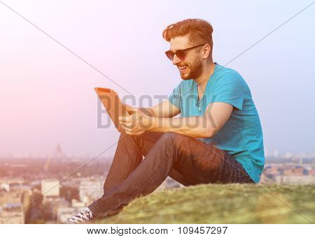 Man Sitting On A Mountain