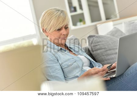 Senior woman doing shopping on internet
