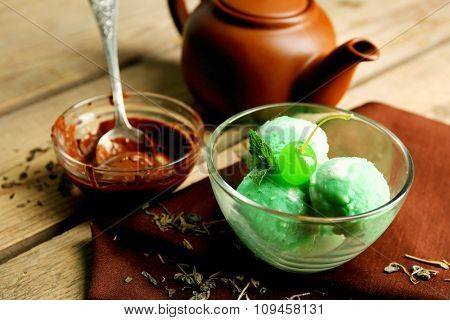 Homemade Green tea ice-cream on dark wooden background