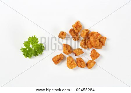 group of pork greaves on white background