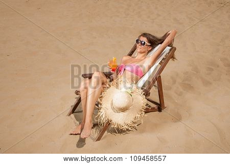 YOung woman suntanning on the beach