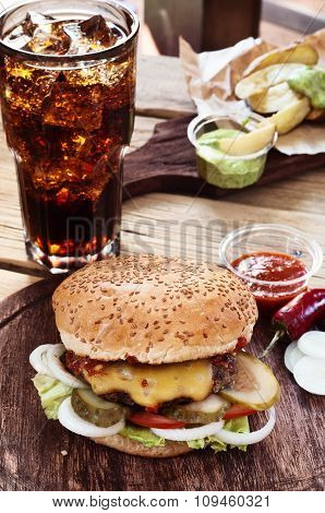 Burger With Cola On A Wooden Table
