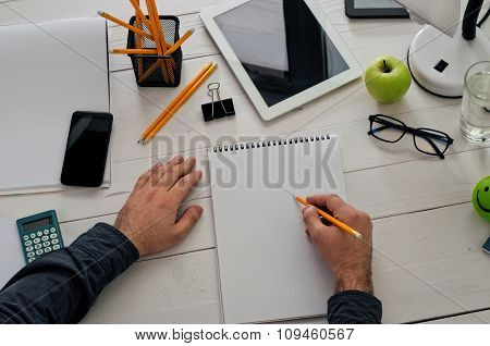 Creative Work. Designer Sitting At A White Desk And Working