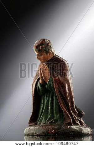 praying figurine