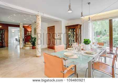 Glass Table And Modern Chairs