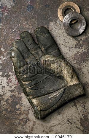 old grubby steel worker glove