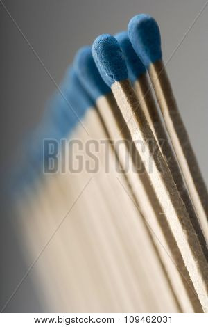 row of blue matches