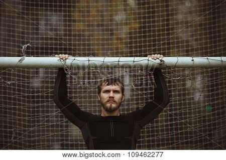 Male athlete resting on soccer field