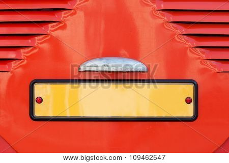 Vintage license car plate number,  Retro style yellow registration nameplate, blank sign. Red paint